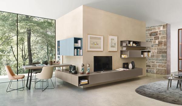 Soggiorni moderni e classici: salotto con mobili a muro, libreria e tavolo ad isola